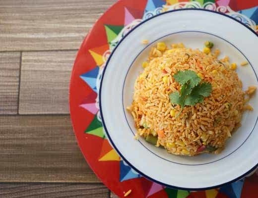 costa rican red plate with arroz con pollo and cilantro