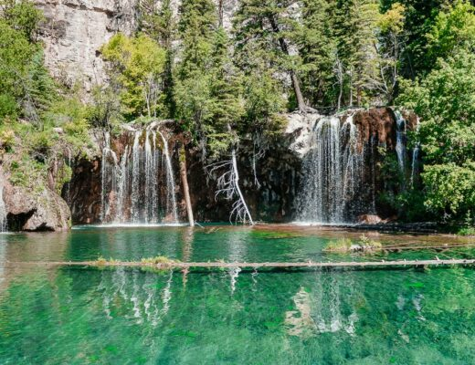 Double waterfalls feeding into a pool at Hanging Lake Trail.