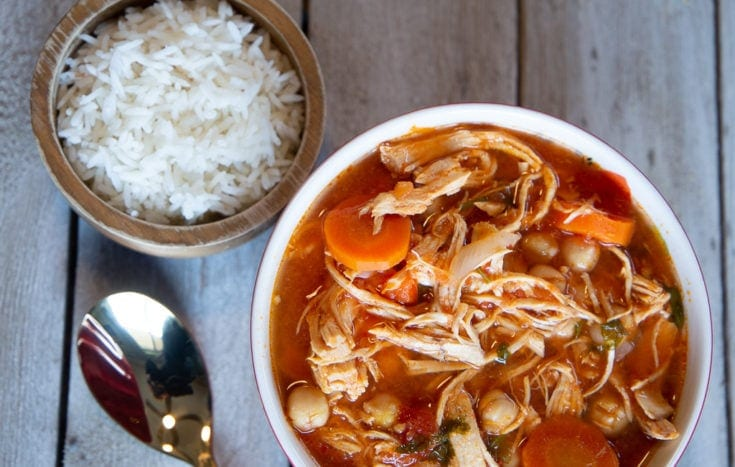 Chicken soup with garbanzo beans, carrots and white rice.