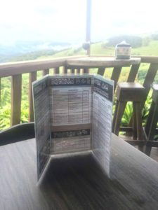 Folded menu on a table at a costa rican restaurant.