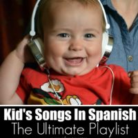 Young Child listening to Spanish songs in a white headset.