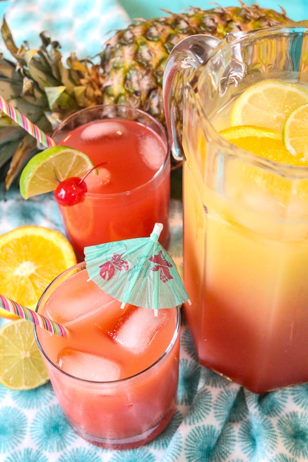 pitcher of tropical rum punch with fresh fruit garnish
