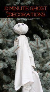 A ghost decoration with a bulb for a head and black eyes.