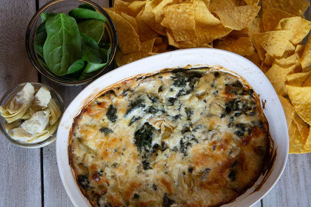 Pyrex pan of baked spinach dip.