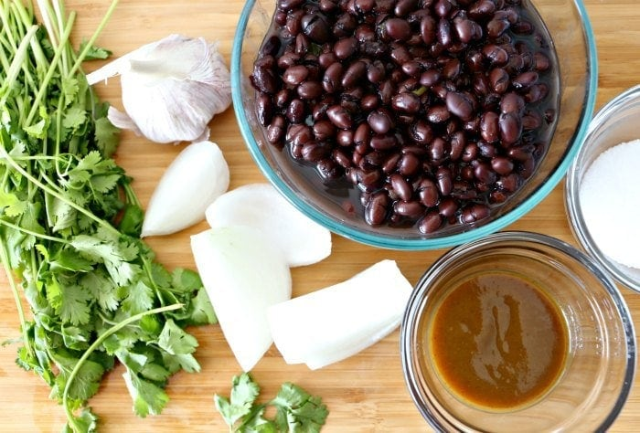 bean dip ingredients- black beans, cilantro, onion, garlic salt and salsa lizano