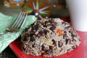Mound of Costa Rican Gallo Pinto on a red plate.