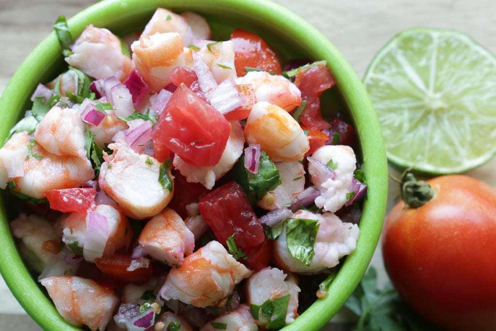shrimp, lime, cilantro tomato on cutting board