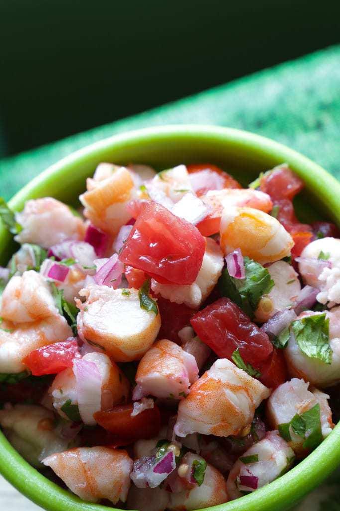 green bowl full of shrimp ceviche