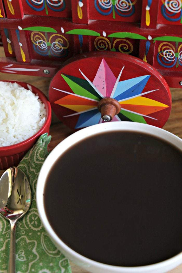 This traditional Costa Rican black bean soup recipe is a delicious, healthy, and simple vegetarian meal that everyone loves! Served with white rice and Salsa Lizano, you can find this dish on most Costa Rican restaurant menus as well.