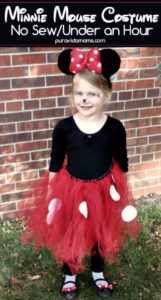 A small girl wearing a Minnie Mouse outfit.