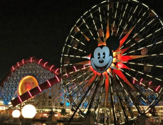 Lit up Mickey Mouse ferris wheel at Pixar Pier Disneyland.