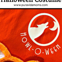 A set of orange cat ears on a cloth with the logo 'HOWL-OWEEN'.