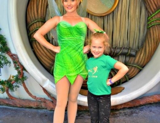 Young girl wearing a DIY shirt posing with Tinkerbell performer.