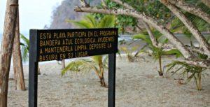 Sign with Spanish text at Playa Mantas Costa Rica.
