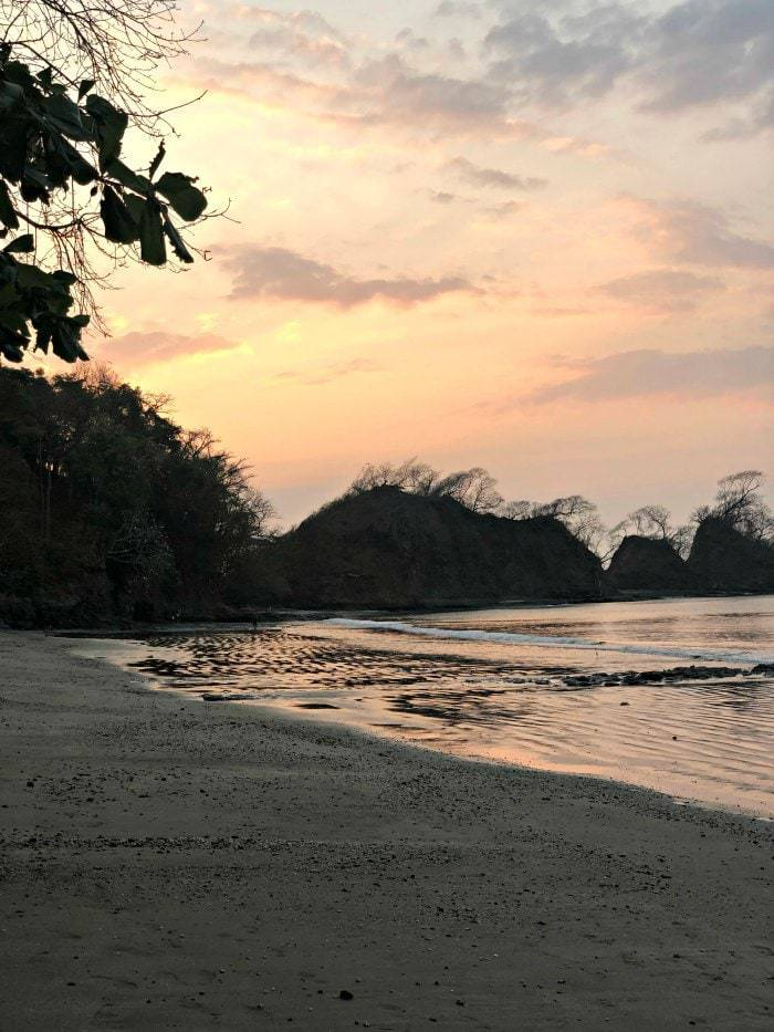 Looking for a quiet, off the beaten path beach just an 1 and 1/2 hours from San Jose, Playa Mantas Costa Rica is the place to go. Bathwater temperature, soft waves, and turquoise water- and did we mention few tourists? #costarica #familybeach #familytravel #costaricabeach #traveltips #puravida #puravidamoms #beachtips