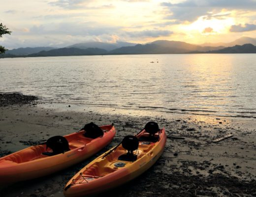 kayaks on bay in costa rica at sunset