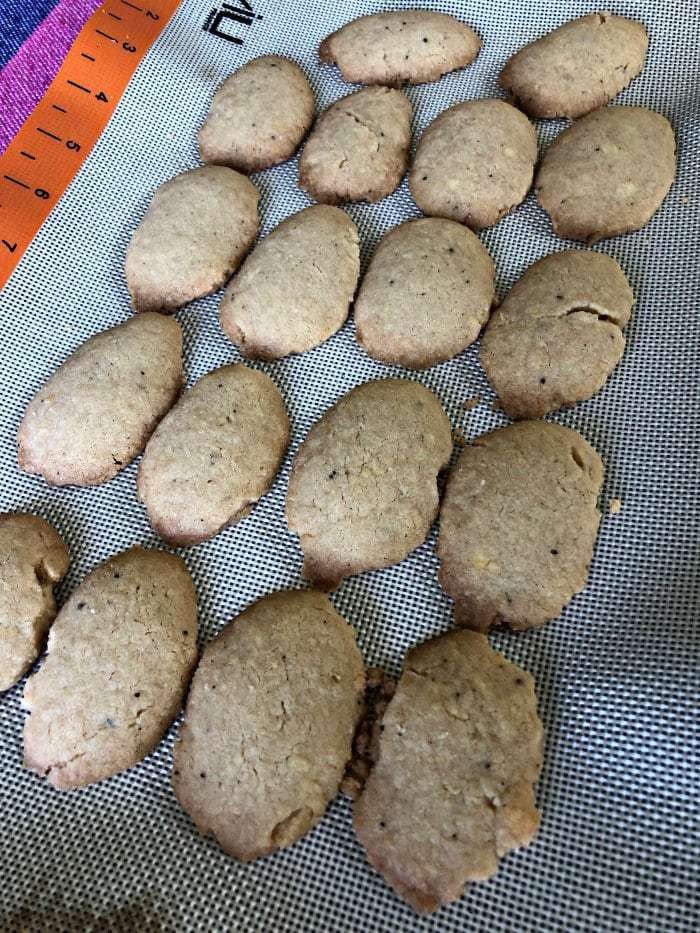 Series of baked Finnish Spoon Cookies on a mat.