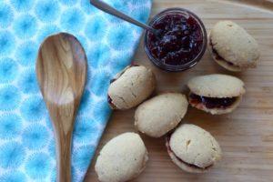 Half dozen Finnish spoon cookies with jar of jam.