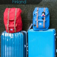 Suitcases in airport - blue and read