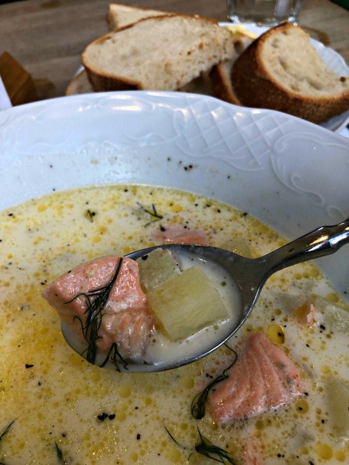 bowl of salmon soup with bread in background helsinki finland