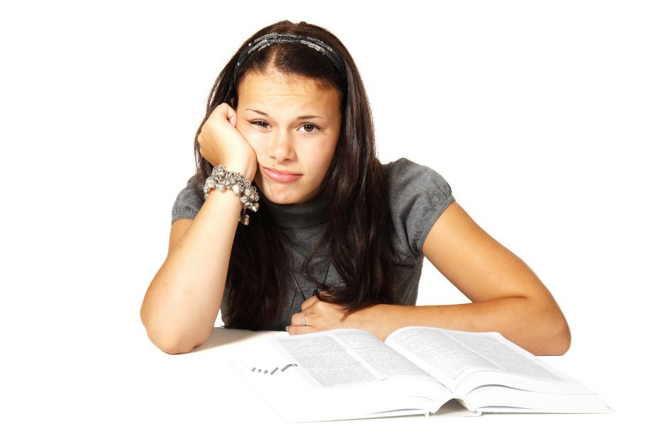frustrated Spanish language student looking at textbook