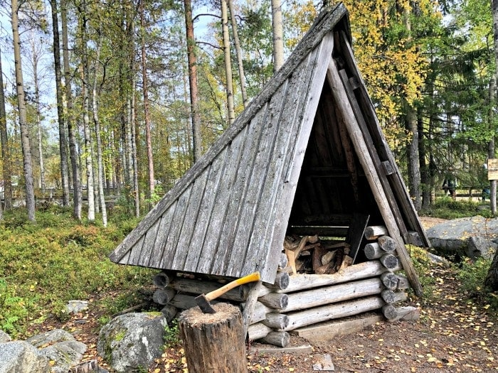 triangula wooden hut in finland with axe in front