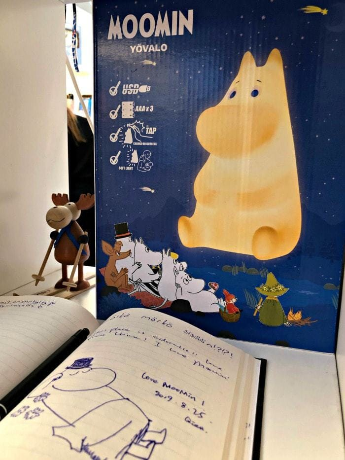 moomin on cardboard with moomin guestbook art
