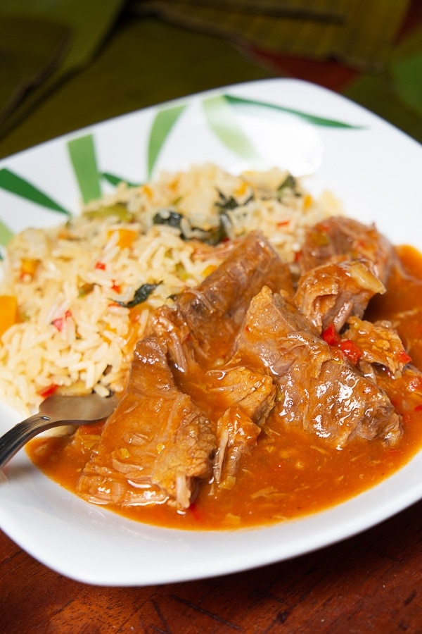 Plate of beefin red sauce with white rice in Costa Rica