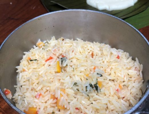 Costa Rican rice in a large stockpot with vegetables and spices