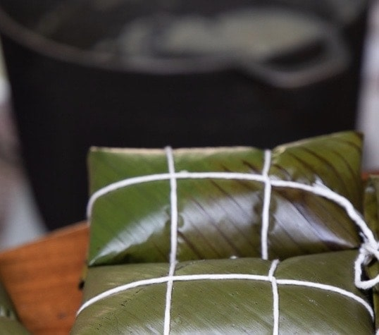 Leaf-wrapped Costa Rican Tamales tied off with twine.