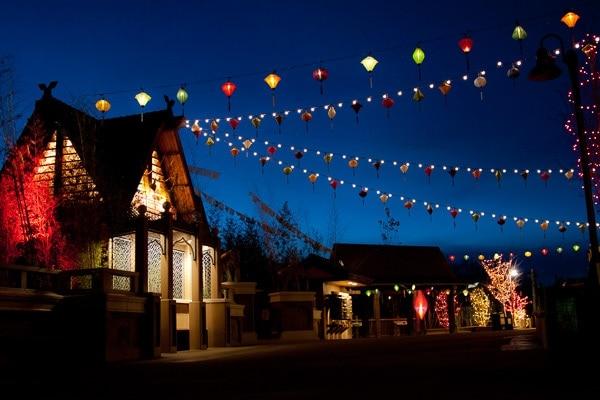 Multiple strands of lanterns tied up between buildings at Denver Zoo Light Festival of Lanterns.