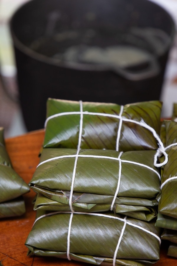 Stacks of leaf-packaged Costa Rican tamales.