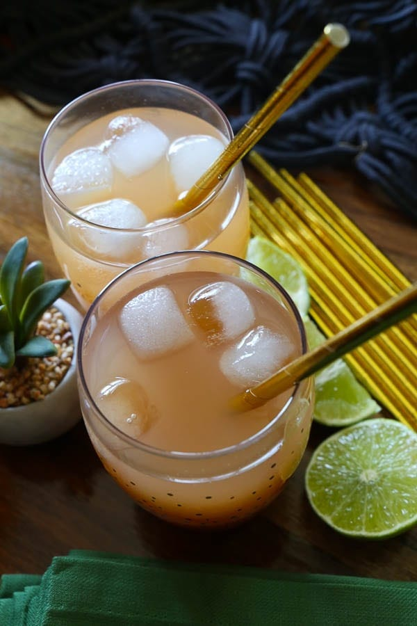 Two moscow mule cocktails with guava and ginger