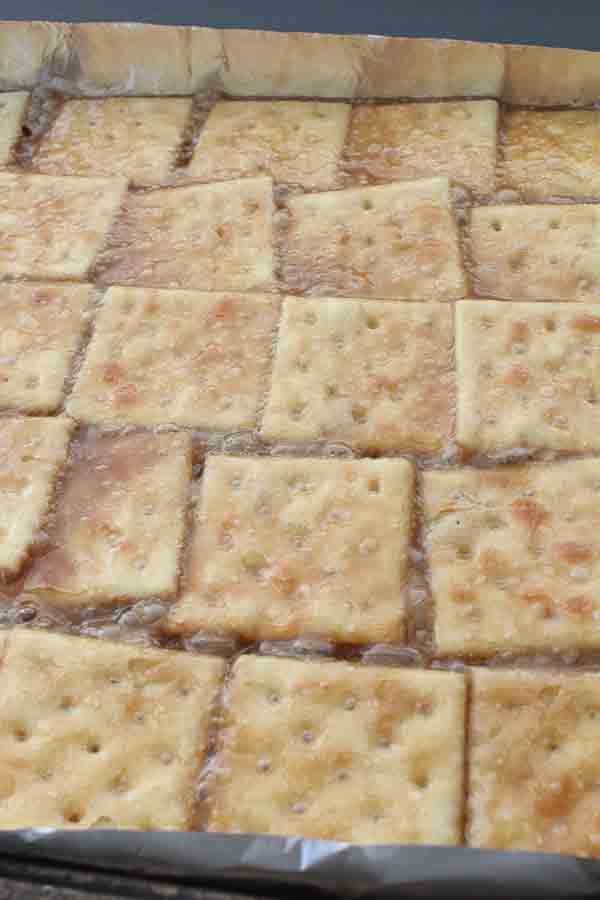 saltine crackers with butter on pan