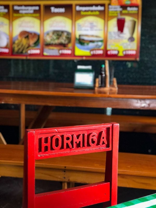 red chair and menu at soda la hormiga la fortuna