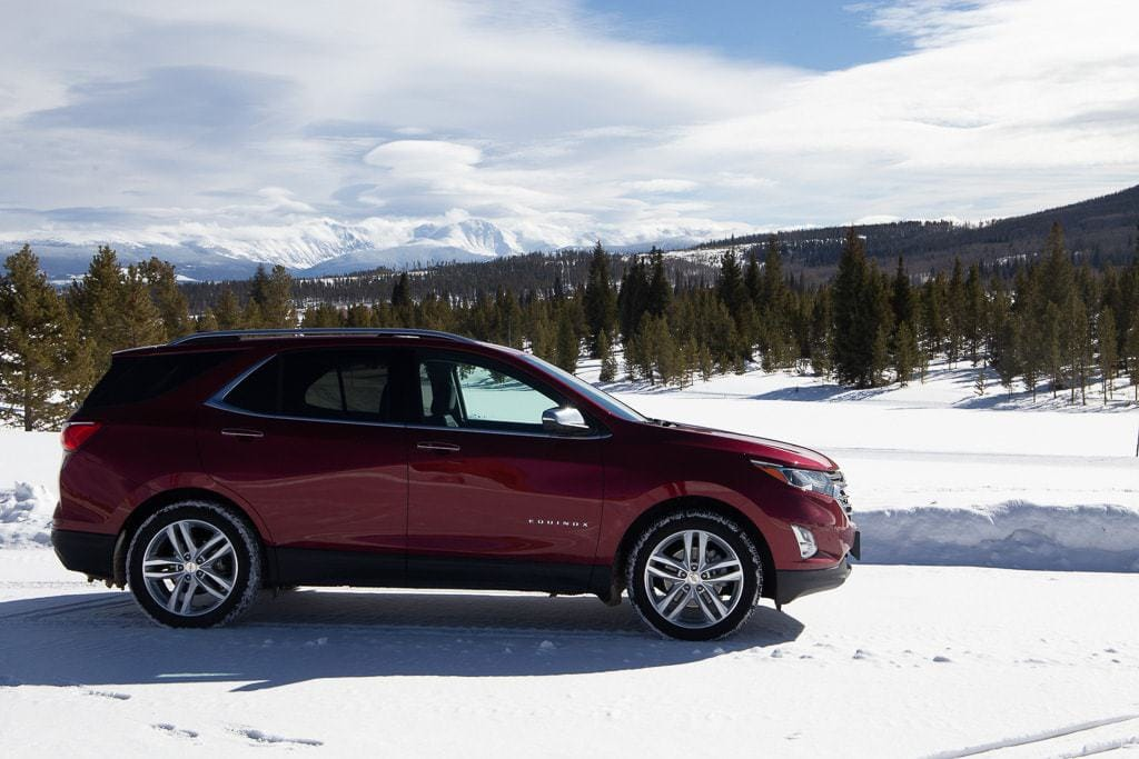 red 2020 chevy equinox in rocky mountains