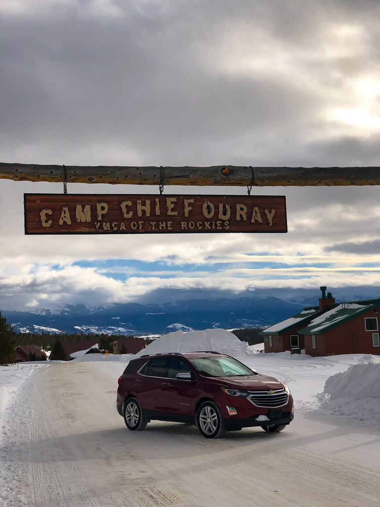 red chevy equinox under cam chief ouray sign at ymca