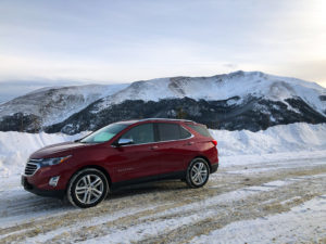 Red Chevrolet Equinox on top of Berthoud pass.