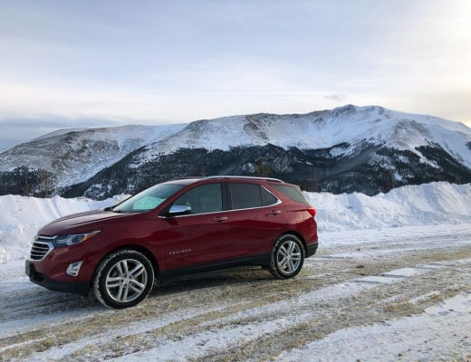 red chevrolet equinox on top of berthoud pass