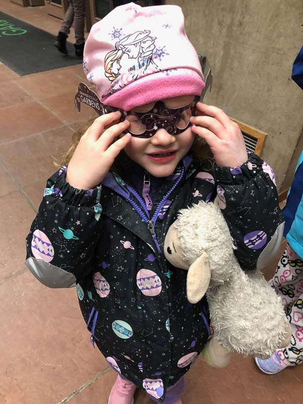 little girl with holospex glasses at denver botanic gardens