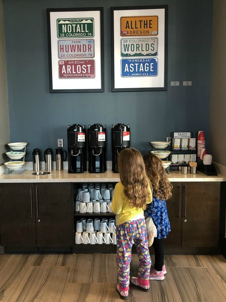 young girls at breakfast buffet coffee station