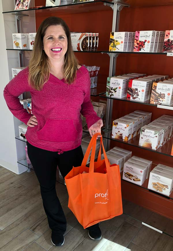 woman holding pink profile bag in weight loss center