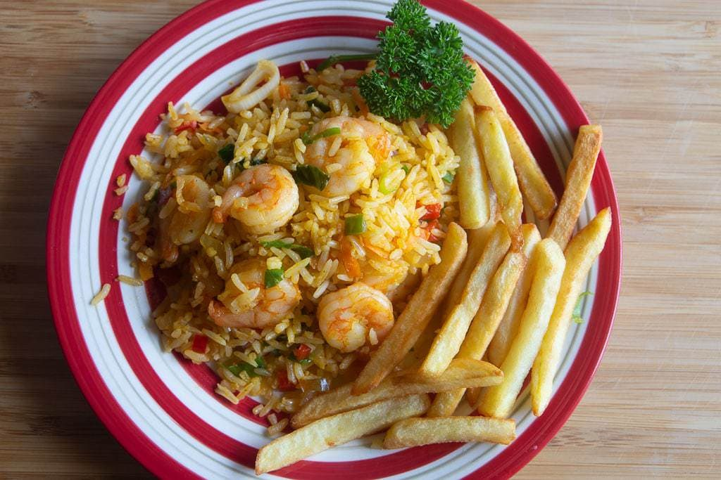 rice with shrimp, french fries and parsley garnish