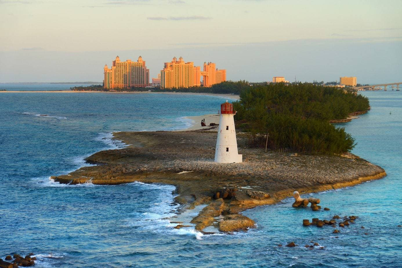 Bahamas lighthouse surrounded by water with Nassau in background