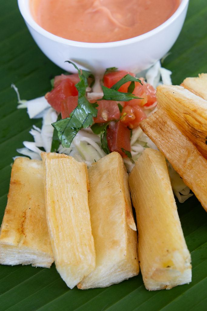 pink sauce with yuca fries on banana leaf from costa rica
