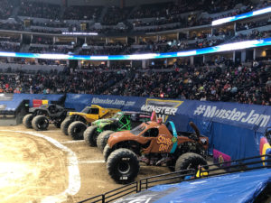 Monster Jam trucks in an arena.