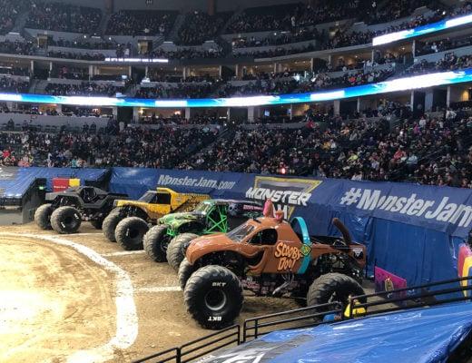 Monster Jam trucks in an arena.