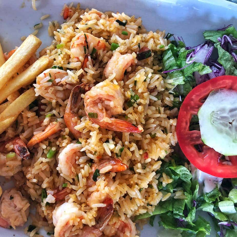 fried rice with tail on garlic shrimp, tomato, cucumber and lettuce