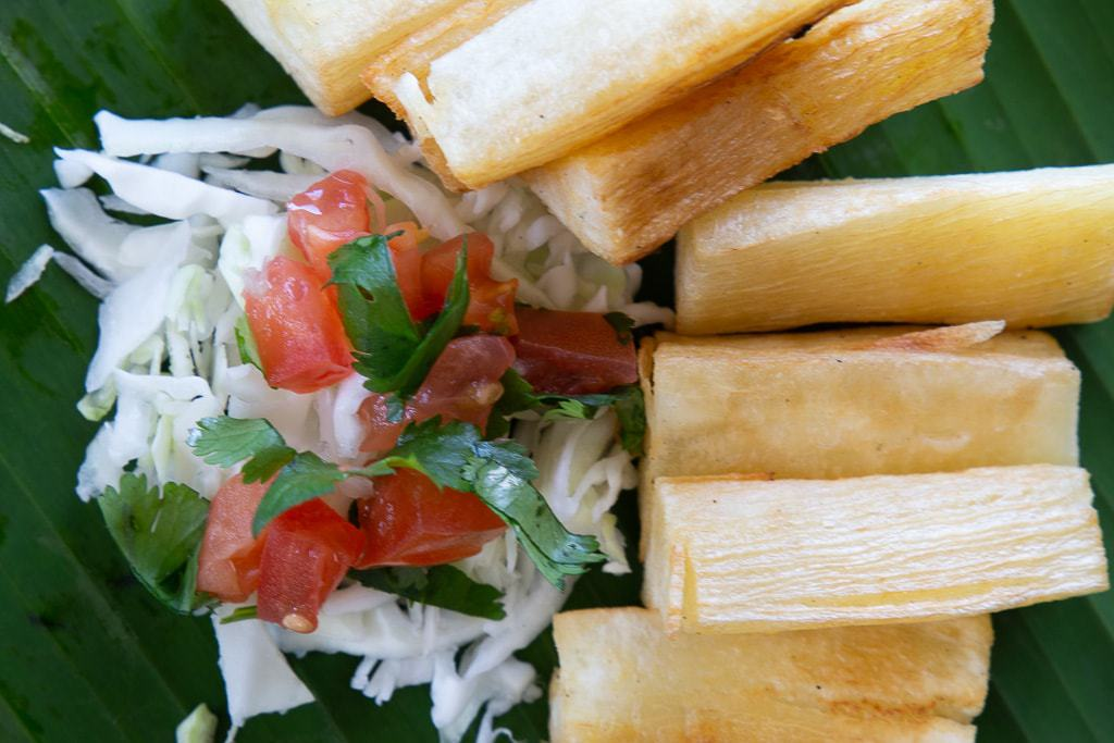 Yuca fries served with cabbage salad and chimichurri sauce.