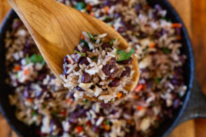 wooden spoonful of gallo pinto above bowl costa rican food
